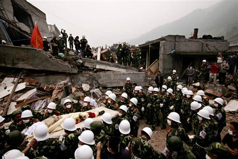 Rescuers carry a survivor from the rubble of a collapsed building in Yinghua town in southwest China's Sichuan province on Friday. www.msnbc.msn.com