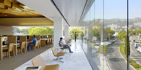 The new West Hollywood Library features a top level with floor-to-ceiling glass and views of the Hollywood Hills. (Benny Chan / Fotoworks / September 28, 2011) www.latimes.com