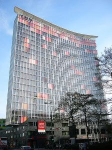 GSW Headquarters building in Berlin. The windows are polychromatic pastel hues of orange and rose when the window shades are closed. Wikipedia